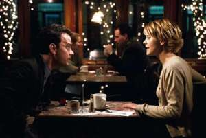 Frank and Kathleen across table in You've Got Mail